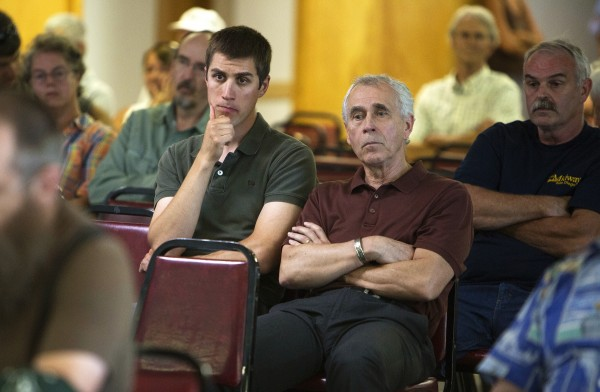 Jeramy Labbe (left) and Michael Barden listen to speakers voice their opinions at the Old Town Elks Lodge in Old Town.
