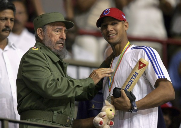 Cuban President Fidel Castro (left) hands out a baseball bat to Cuban player Yulieski Gourriel in Havana in this March 2006 file photo.