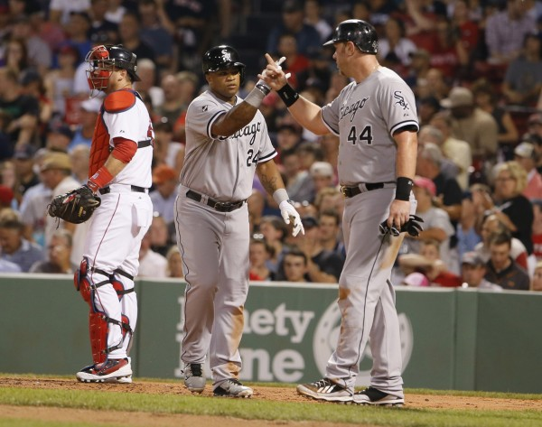 Chicago's Dayan Viciedo (24) is congratulated by teammate Adam Dunn (44) after hitting a three-run home run against the Boston Red Sox in the fourth inning at Fenway Park in Boston Monday night. The White Sox won 4-0.