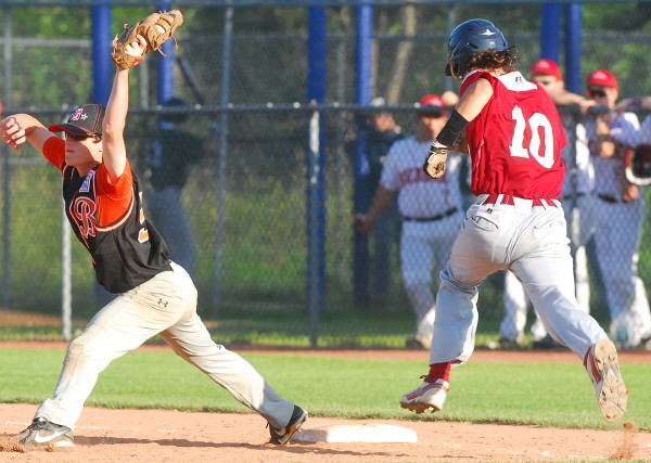 Bangor's Derek Fournier is out at first base on a close play as Brewer first baseman Jack Corey holds onto the throw during a District 3 Senior League tourney game at Mansfield Stadium in Bangor Friday. Bangor won 8-3.