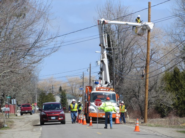 Central Maine Power Co. workers replace a utility pole that was knocked down in South Thomaston by a vehicle April 18, 2014.