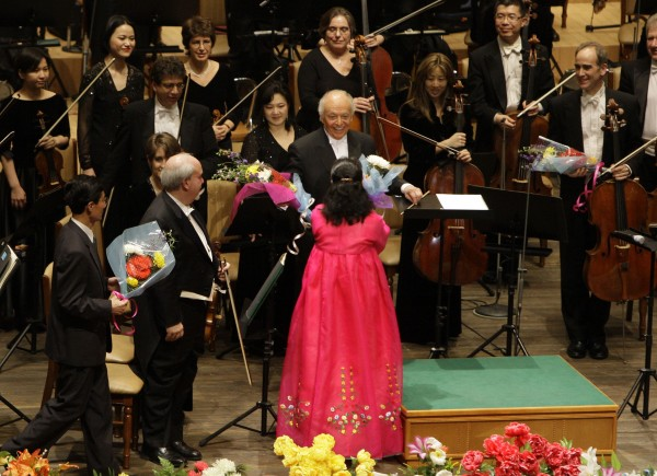 Music Director Lorin Maazel (center) reacts as he is handed flowers after conducting the New York Philharmonic during their concert at the Grand Theatre in the North Korean capital of Pyongyang in this February 2008 file photo.