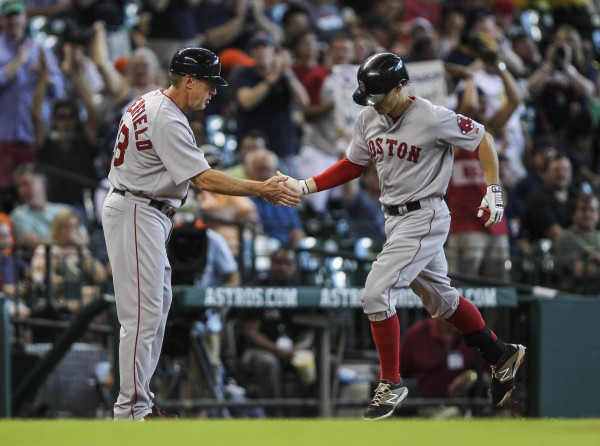 Boston Red Sox third baseman Brock Holt (right) is congratulated by third base coach Brian Butterfield after hitting a home run during the first inning against the Houston Astros at Minute Maid Park on Sunday.
