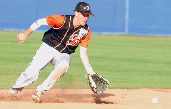 Brewer shortstop Logan Rogerson fields a ground ball from a Bangor batter during a District 3 Senior League tourney game at Mansfield Stadium in Bangor. Bangor won 8-3.