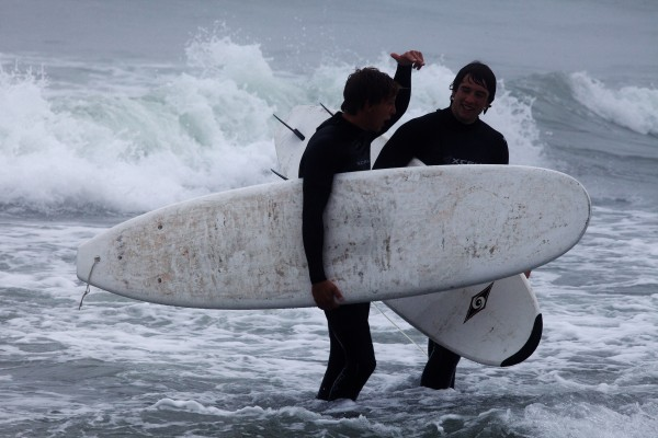 Tales are exchanged as two surfers call it a day at Higgins Beach in Scarborough on Wednesday.