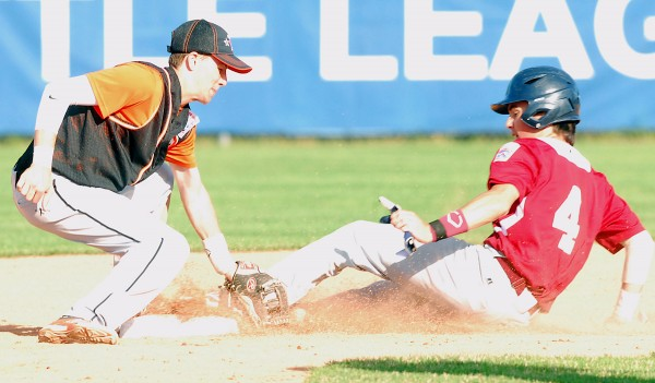 Bangor's Kyle Stevenson slides under the tag by Brewer shortstop Logan Rogerson for a stolen base during Senior League all-star action in the District 3 tourney Friday at Mansfield Stadium in Bangor.
