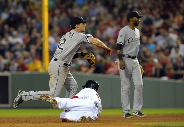 Boston's Dustin Pedroia is forced out by Chicago White Sox third baseman Conor Gillaspie (12) who turns a double play to end the game at Fenway Park in Boston Tuesday night.