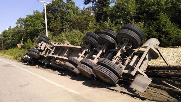 Waldo McMannis was lucky to escape with just minor injuries on his head after the logging truck he was driving tipped over on Route 6 in Topsfield on Monday, Springfield Volunteer Fire Department Chief Jim White said.