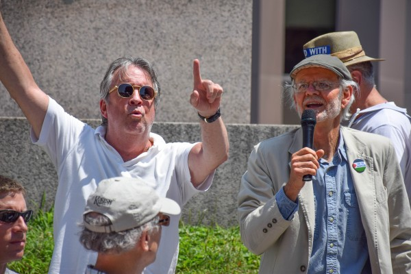 Jeffery Lombard, left, a supporter of Israel who traveled from New Hampshire for the protest, attempts to distract the crowd from Bob Schaible, right, chair of Maine Voices for Palestinian Rights.