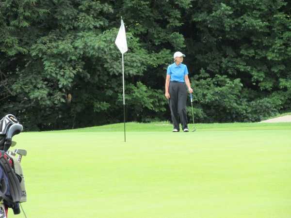 Leslie Guenther waits her turn to putt during Wednesday's final round of the Maine Women's Amateur golf championship at Waterville Country Club. She beat Mary Brandes by two strokes to take the title.