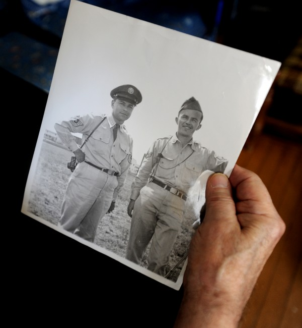 Mario &quotLee&quot Sirabella, of Brewer, holds a photograph of himself (left) with another soldier.  Sirabella photographed the salvaging of the B-17 aircraft that crashed near Rangeley in 1944.