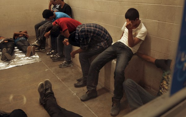 Immigrants who have been caught crossing the border illegally are housed inside the McAllen Border Patrol Station in McAllen, Texas July 15, 2014, where they are processed.