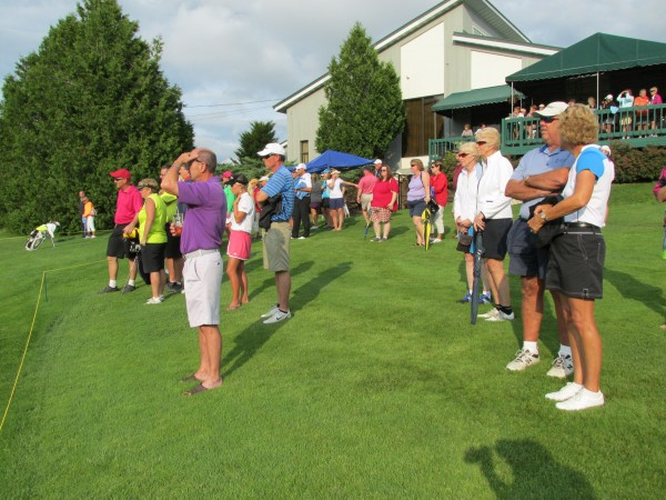 Members of the gallery gather at the 18th green at Waterville Country Club in Oakland on Wednesday to watch the final threesome finish out the second round. Leslie Guenther of Norway Country Club took a two-stroke victory.