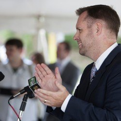 C&L Aerospace CEO Chris Kilgour address the crowd during a press conference Thursday at the company''s new $5 million headquarters expansion near the Bangor International Airport terminal.