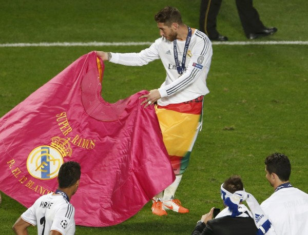 Real Madrid's Sergio Ramos performs a bull fight as he celebrates after defeating Atletico Madrid in their Champions League final soccer match at the Luz Stadium in Lisbon May 24, 2014. The franchise is worth $3.44 billion, the highest of any sports team in the world.