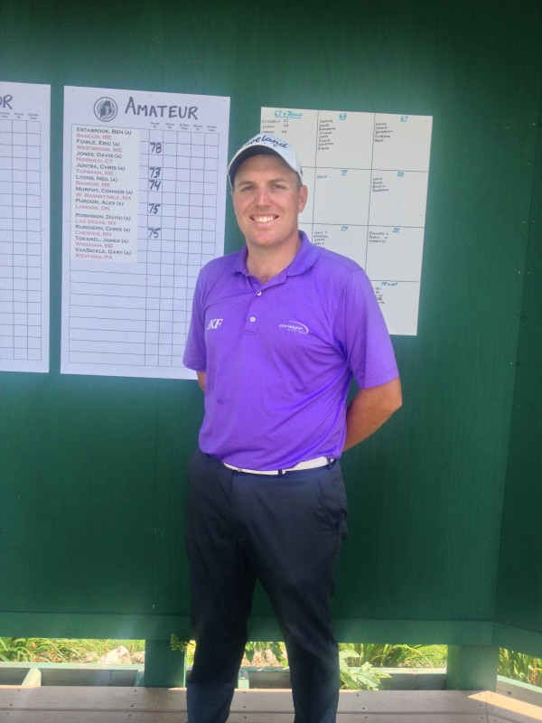 Mike Van Sickle stands next to the Greater Bangor Open scoreboard at Bangor Municipal Golf Course after shooting a course-record 60 Thursday in the first round of the tournament.