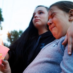 Saco community gathers to grieve 'unspeakable horror'
