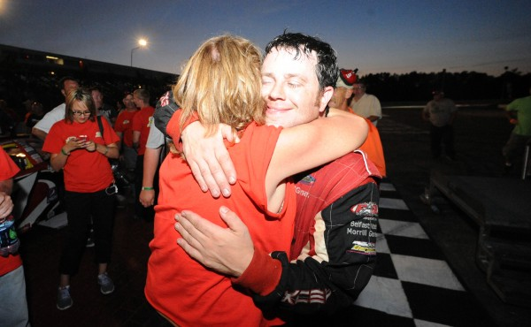Travis Benjamin of Morrill hugs his mother, Sharon Benjamin, after winning the TD Bank Oxford 250 in July 2013.
