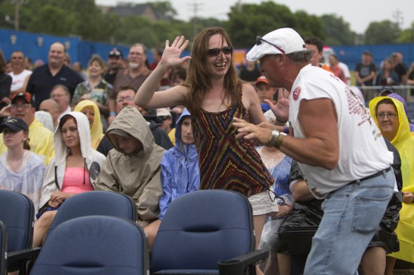 Marie Jordan (left) and Curtis McAlister dance during the Boston and Cheap Trick concert Wednesday at Darling's Waterfront Pavilion in Bangor.