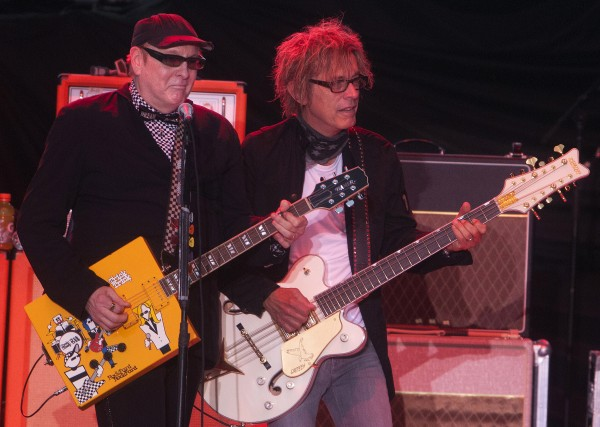 Cheap Trick's Rick Nielsen  (left) and Tom Petersson play during the Boston and Cheap Trick concert Wednesday at Darling's Waterfront Pavilion in Bangor.