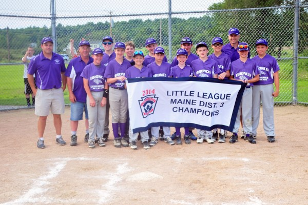 Members of the Bronco Little League all-star team show off their chammpionship banner Monday after beating Hermon 5-1 in the District 3 championship game in Hermon.