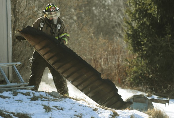 Mike Azevedo removes a charred section of a garage on Horseback Road in Carmel Jan. 25, 2013. The former Carmel fire chief hopes to be given a reason for his dismissal.