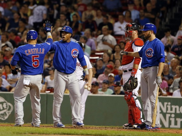 Chicago Cubs' Welington Castillo (5) is congratulated at home plate by  third baseman Luis Valbuena (24) after hitting a two-run home run against the Boston Red Sox in the fifth inning at Fenway Park in Boston Wednesday night.