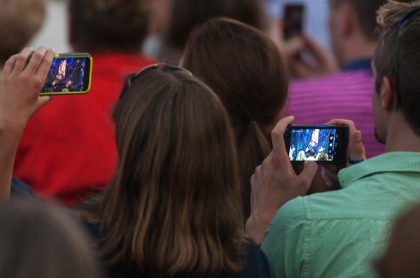 Concert goers take photos and video with their cellphones during the Sarah McLachlan show at the Darling's Waterfront Pavilion on Friday in Bangor.