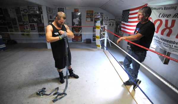 Boxer Brandon Berry of West Forks talks to his trainer Ken &quotSkeet&quot Wyman, owner of Wyman's Boxing Club in Stockton Springs. Wyman, a former boxer, started the club 10 years ago and Berry is the first professional boxer he has trained.