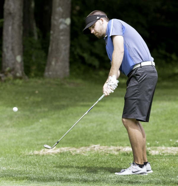 After missing the green on hole 16, Andrew Slattery chips the ball to within three feet of the cup during the final day of the Maine Amateur Golf Championship in Falmouth on Thursday.