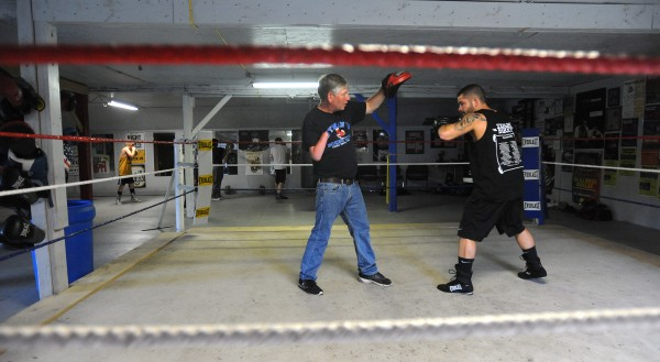 Professional boxer Brandon Berry (right) of West Forks works out with his trainer Ken &quotSkeet&quot Wyman at Wyman's Boxing Club in Stockton Springs. Berry started boxing at Wyman's club six years ago and turned pro in May 2013.