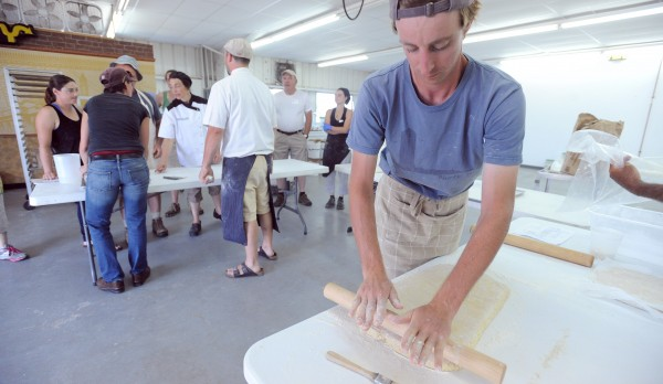 Jeff Dec of Camden rolls out dough during the Wood-Fired Production Bakery Workshop at the 2014 Kneading Conference in Skowhegan on Friday.