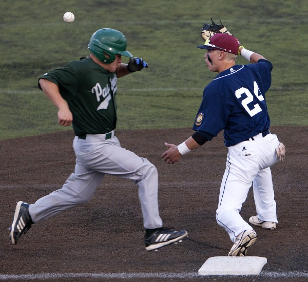 Bangor's Trevor DeLaite (right) misses the throw to first allowing Pastime Club's Alex Small to be safe during their American Legion state baseball tournament game Thursday at Husson University in Bangor.