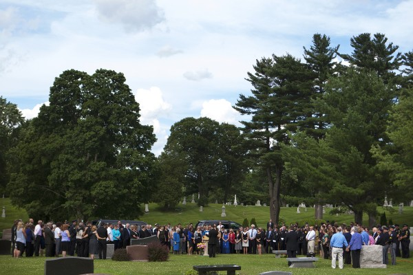 Many members of the community came out to pay their final respects to former Bangor police chief Don Winslow Thursday at Mount Pleasant Cemetery.