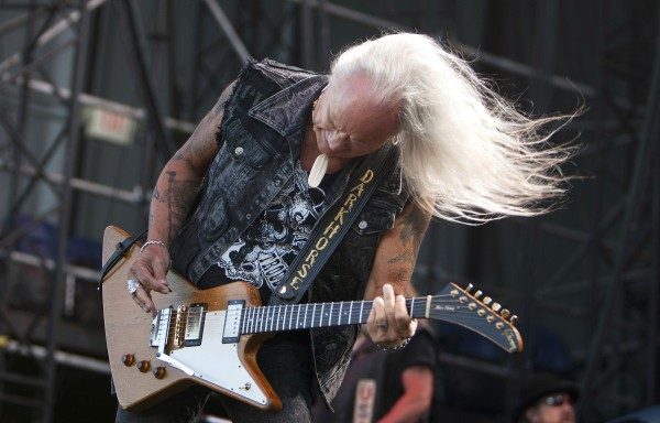 Lynyrd Skynyrd's Rickey Medlocke plays the guitar during the Bad Company and Lynyrd Skynyrd show at the Darling's Waterfront Pavilion in Bangor.