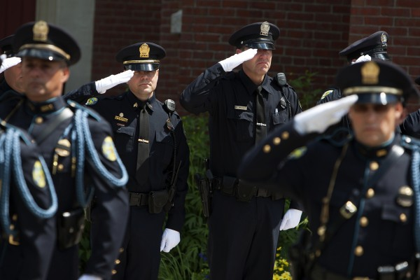 Bangor police officers pay their final respects to former Bangor police chief Don Winslow Thursday.