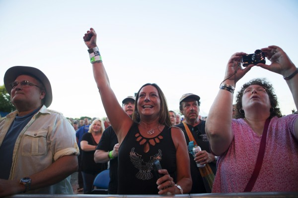 Brenda Hays (center) takes in the show during the Bad Company and Lynyrd Skynyrd show at the Darling's Waterfront Pavilion in Bangor.