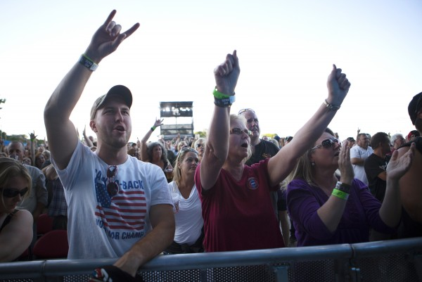 Jason Hall (left) and Carol Bell rock out during the Bad Company and Lynyrd Skynyrd show at the Darling's Waterfront Pavilion in Bangor.