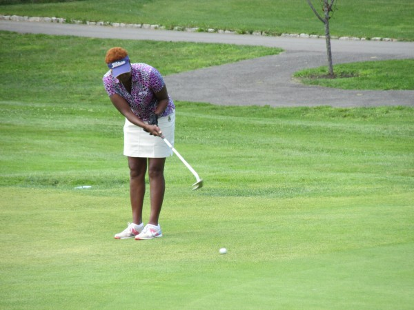 Prudence Hornberger of Turner Highlands Golf Course putts from the apron onto the 18th green during Tuesday's first round of the Maine Women's Amateur Golf Tournament at Waterville Country Club. Hornberger shot an 80 and is only five shots off the pace.