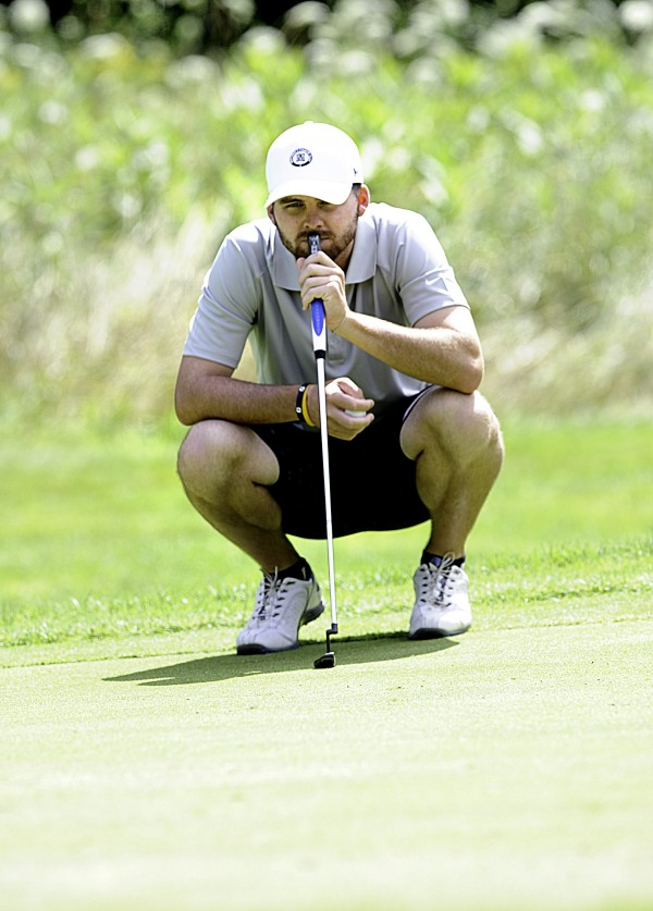 Maine Amateur 2014 champion Andrew Slattery contemplates his shot during the 2014 Charlie's Maine Open Tuesday in Augusta. Slattery finished the one-day tournament even.