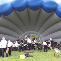 "The Bangor Band prepares for a concert in their ""Bangor Clamphitheater"" concert shell"
