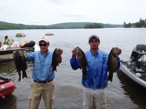 Hunter Pate, a senior at John Bapst High School in Bangor, and Jacob Gauvin, a junior at Bucksport High School in Bucksport, show of the the bass they caught to earn them the 2014 Student Angler Federation Maine State High School Bass Fishing Championship on July 19 at Brewer Lake.