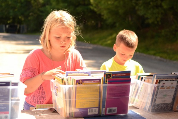 Children choose books from the bookmobile collection.