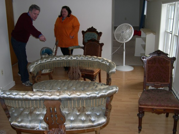 Executive Director Jennifer Blanchard and Board member Troy Ancona of the Pejepscot Historical Society inspect water damage in the Joshua L. Chamberlain Museum.