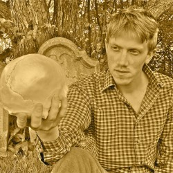 Dan Mahler as Hamlet communes with the skull of his old friend Yorick.