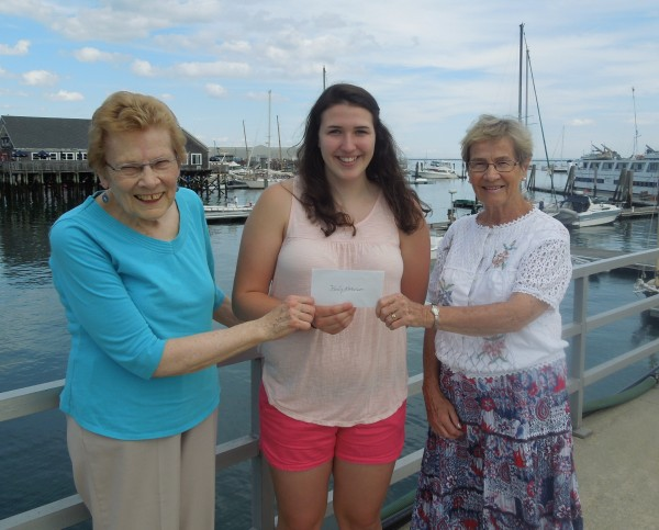 Karly Robinson, center, receiving scholarship from Beth Guiseley, Chairman on left, and Nancy Greenier, right