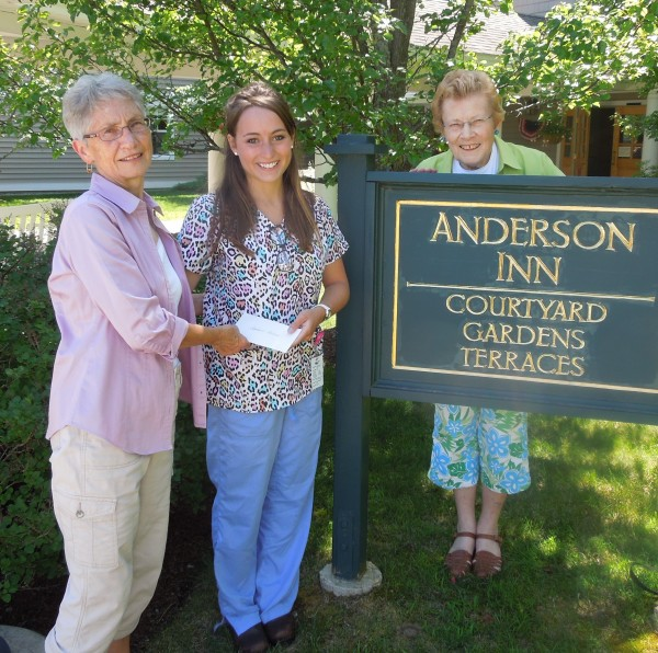 Stephanie Leclerc receiving scholarship from Nancy Cox, left, and Chairman, Beth Guiseley, right