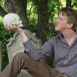Dan Mahler as Hamlet communes with the remains of his old friend Yorick.