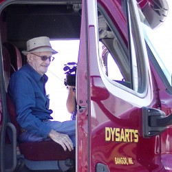 Thomas Follette, 100, sits in a truck at Dysart's. His wish to ride in &quotbig rig&quot was fulfilled, in part, by the Maine Health Care Association Live Your Dreams program.