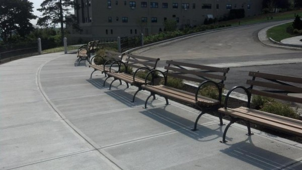 Period-style benches now line Fort Allen Park's overlook of Casco Bay.